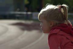 A menina no estádio Imagens de Stock Royalty Free