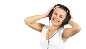 Menina no fone de ouvido Fotografia de Stock