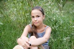 Menina no fundo da grama Imagem de Stock Royalty Free