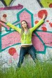 Menina no fundo dos grafittis Imagem de Stock Royalty Free
