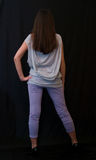 Menina no fundo preto Imagens de Stock