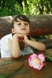 Menina no jardim Fotos de Stock