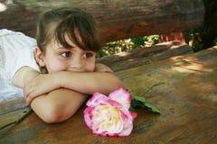 Menina no jardim Fotos de Stock Royalty Free