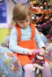 Menina no jardim de infância com boneca imagem de stock royalty free