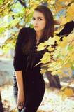 Menina no jardim do outono Imagens de Stock Royalty Free