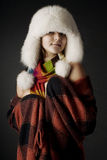 Menina no lenço um pele-tampão Fotos de Stock Royalty Free