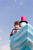 Menina no parque de diversões Fotos de Stock