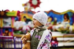 Menina no parque de diversões Fotos de Stock Royalty Free