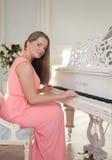 Menina no piano Imagem de Stock Royalty Free