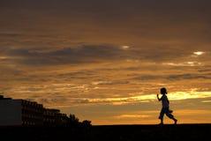 Menina no por do sol Imagem de Stock Royalty Free