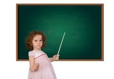 Menina no quadro-negro com um ponteiro fotografia de stock