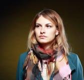 Menina no revestimento e no lenço Imagens de Stock Royalty Free