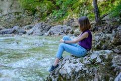 A menina no rio Imagem de Stock