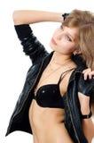 Menina no roupa interior e em um revestimento de couro Foto de Stock Royalty Free