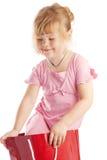 Menina no saco de papel vermelho Imagem de Stock Royalty Free