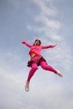 Menina no salto imagem de stock royalty free