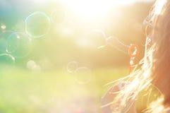 Menina no sol do verão Foto de Stock Royalty Free