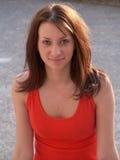 Menina no sorriso vermelho Imagens de Stock Royalty Free