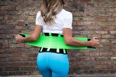 Menina no sportswear com um espartilho imagem de stock royalty free