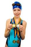 Menina no swimsuit com medalhas Fotos de Stock Royalty Free