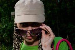 Menina no tampão Fotografia de Stock