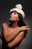 Menina no tampão branco Imagem de Stock Royalty Free