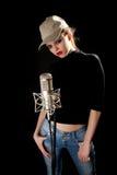 Menina no tampão com microfone Fotografia de Stock Royalty Free