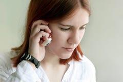 Menina no telefone Imagens de Stock Royalty Free