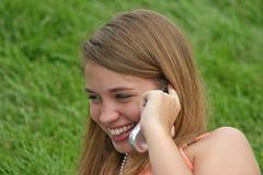 Menina no telefone de pilha Imagens de Stock