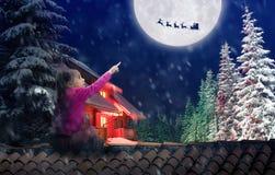 Menina no telhado na Noite de Natal fotografia de stock