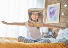 Menina no traje do astronauta Imagens de Stock
