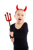 Menina no traje do diabo. imagens de stock
