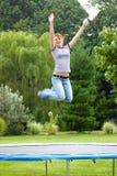 Menina no Trampoline Fotos de Stock Royalty Free