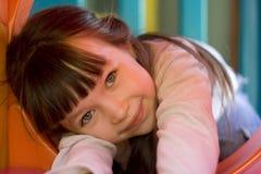 Menina no tunel no campo de jogos Imagens de Stock