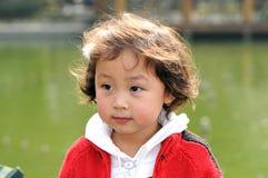 Menina no vermelho Fotografia de Stock
