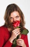 A menina no vermelho com uma flor Foto de Stock Royalty Free