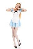 Menina no vestido azul com cabelo longo em um fundo branco fotografia de stock royalty free