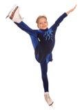 Menina no vestido azul em patins. Fotos de Stock Royalty Free