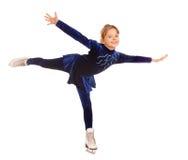 Menina no vestido azul em patins. Fotos de Stock