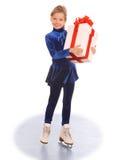 Menina no vestido azul em patins. Imagem de Stock