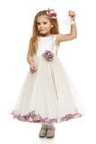 Menina no vestido bonito que guardara sinos Fotografia de Stock