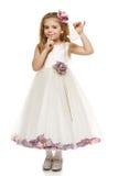 Menina no vestido bonito que guardara sinos Fotografia de Stock Royalty Free