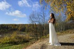 Menina no vestido branco Imagem de Stock Royalty Free