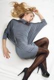 Menina no vestido cinzento Fotos de Stock Royalty Free