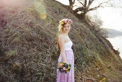 Menina no vestido com às bolinhas Fotos de Stock