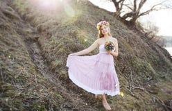 Menina no vestido com às bolinhas Fotografia de Stock Royalty Free