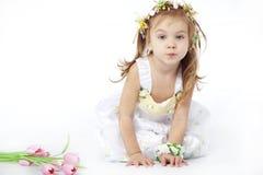 Menina no vestido da flor Fotos de Stock