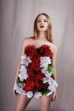Menina no vestido das flores Foto de Stock Royalty Free