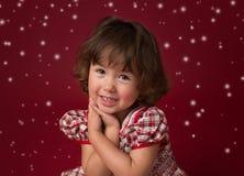 Menina no vestido do Natal, no equipamento com luzes e nos flocos da neve Imagens de Stock Royalty Free
