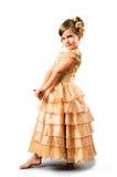 Menina no vestido do ouro isolado no branco Foto de Stock Royalty Free